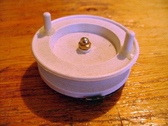 Сопряжение ручек катушки с верхней поверхностью шпули